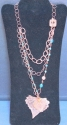 multi-layered copper and crystal necklace with chain accent.